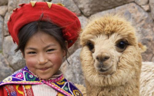 kirkland-dennis-girl-in-native-dress-with-baby-alpaca-sacsayhuaman-inca-ruins-cusco-peru.jpg